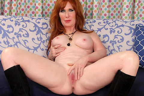 Redhead granny Freya Fantasia gets naked for you